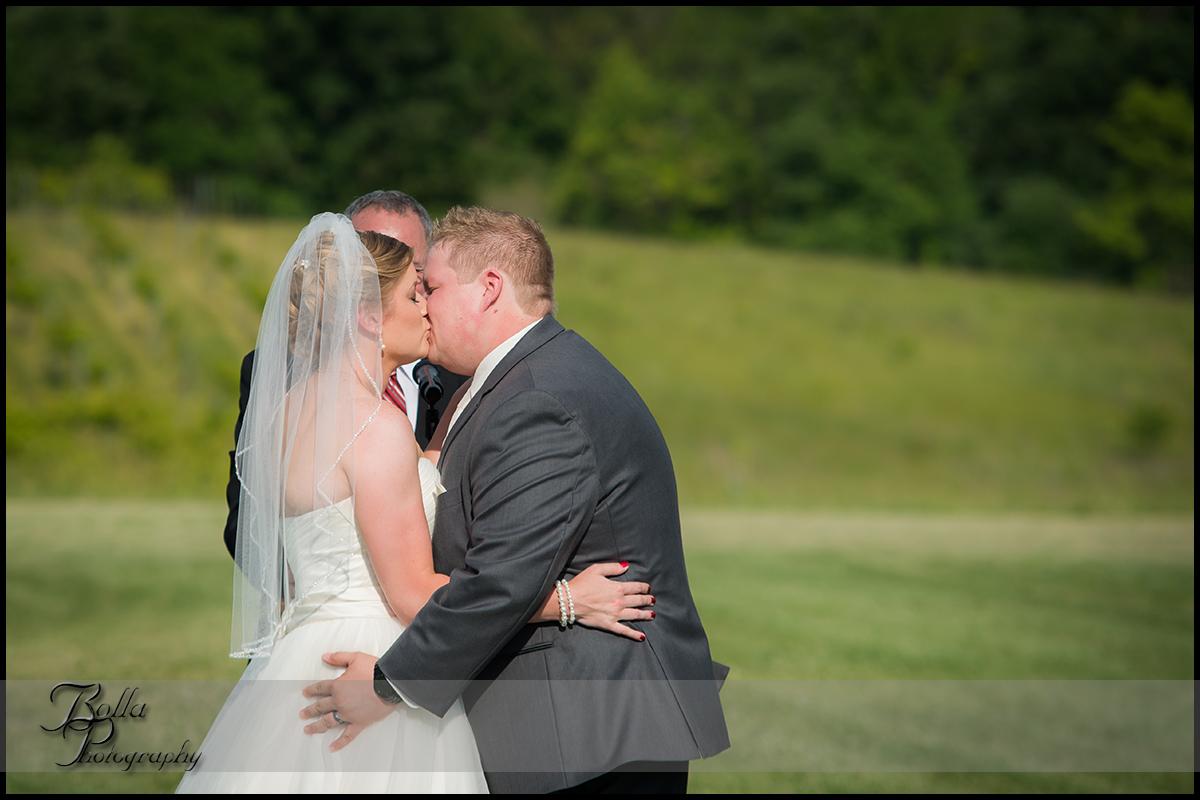 012-villa-marie-winery-maryville-il-wedding-groom-bride-outdoor-ceremony-first-kiss.jpg