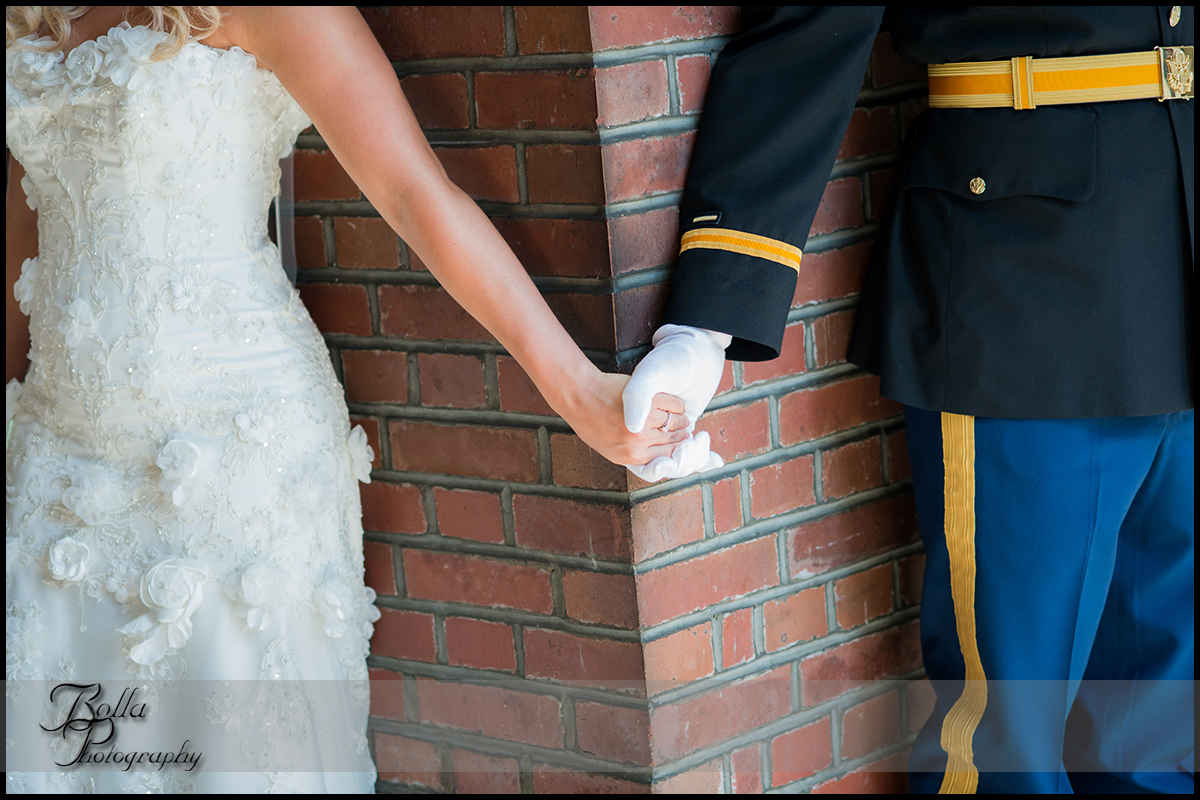 004-provincial_house_chapel-church-saint_louis-mo-wedding-bride-groom-holding-hands-first-look-brick-military-uniform.jpg