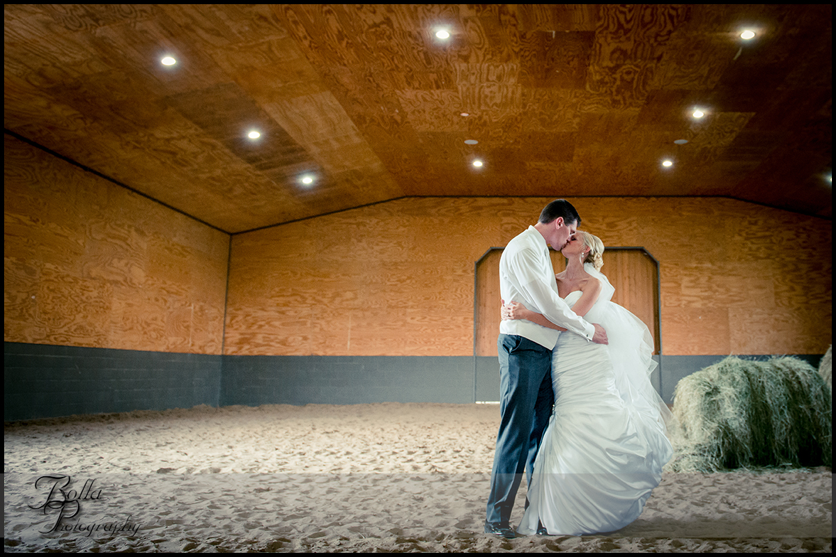 016_Bolla_Photography-wedding-portraits-bride-groom-couple-barn-hay-kiss-Breese-Gerstner.jpg