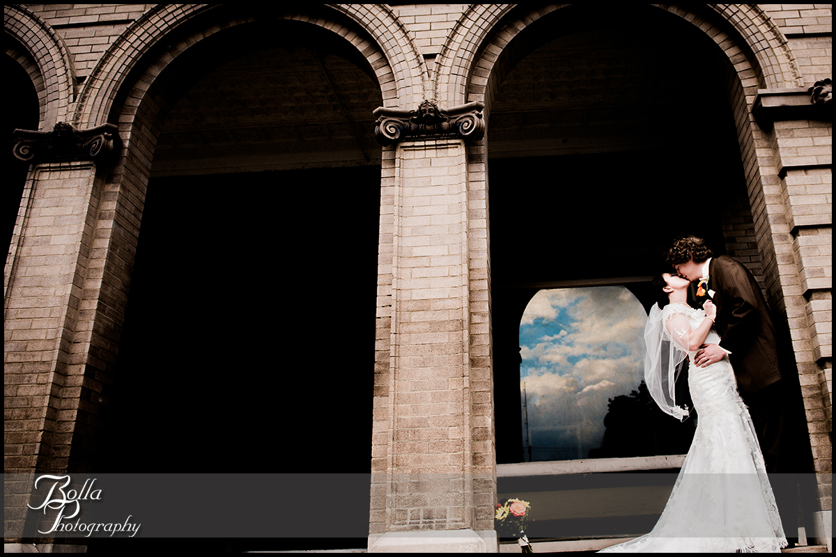 001_Bolla_Photography-wedding-fall-portraits-bride-groom-couple-kiss-Breese-Kuhl-arches-clouds.jpg