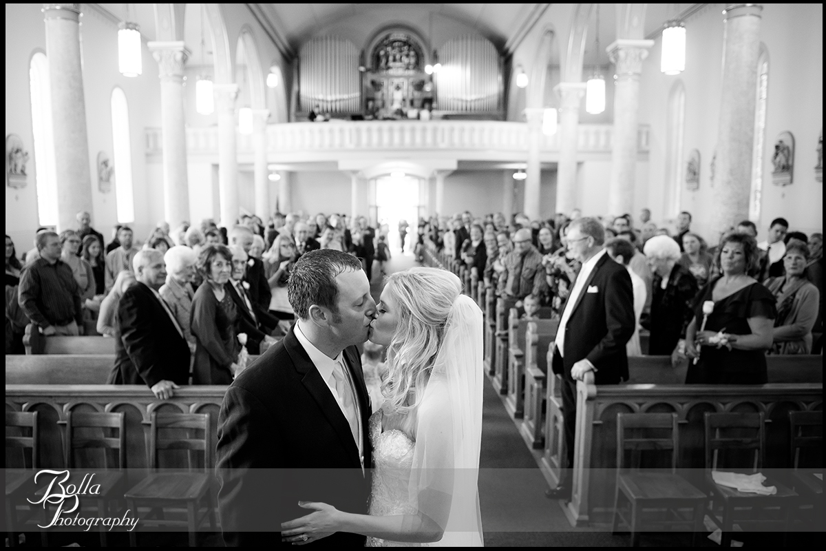 011-Bolla-Photography-wedding-Germantown-IL-ceremony-church-bride-groom-kiss-altar-guests-Albers.jpg