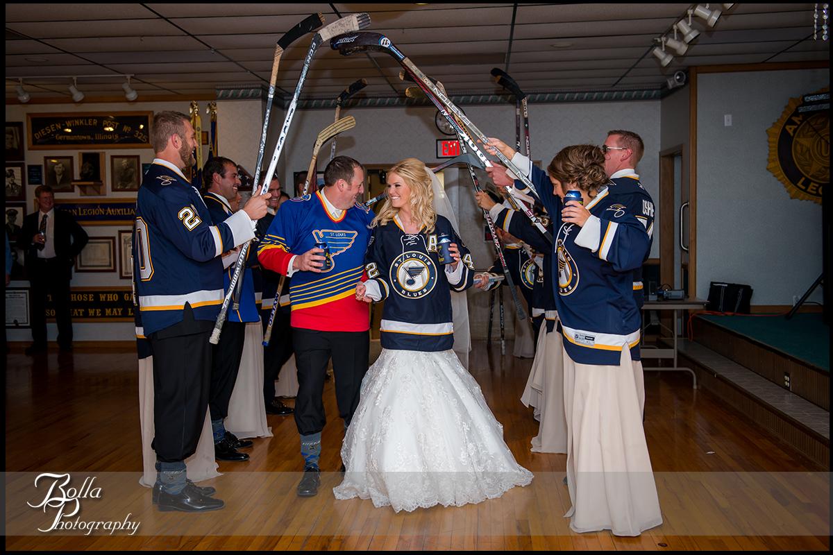 018-Bolla-Photography-wedding-Germantown-IL-reception-bride-groom-American-Legion-entrance-introductions-couple-blues-hockey-sticks-jerseys-Albers.jpg