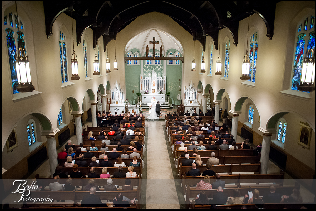 008-Bolla-Photography-wedding-Belleville-IL-ceremony-church-groom-bride-altar-Wilson.jpg