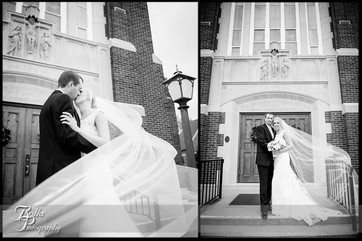 012-Bolla-Photography-wedding-Belleville-IL-bride-groom-portraits-church-wind-veil-kissing-Wilson.jpg