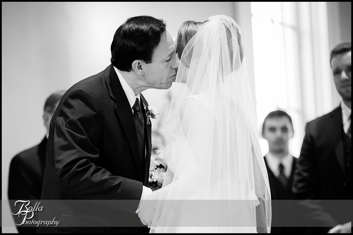 008-Bolla-Photography-Saint-Louis-wedding-photographer-McKendree-Bothwell-Chapel-Lebanon-IL-ceremony-Regency-OFallon-IL-reception-father-bride-kiss-groom-McClain.jpg
