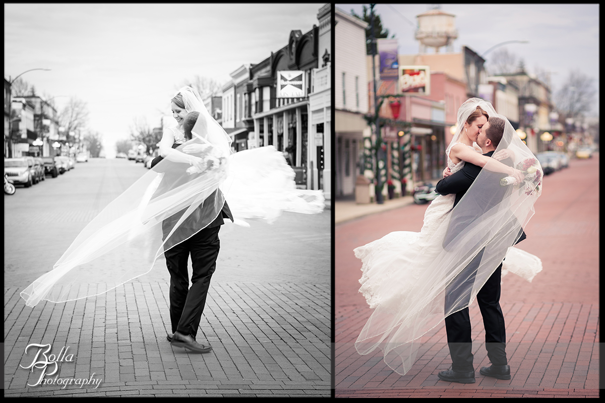 017-Bolla-Photography-Saint-Louis-wedding-photographer-McKendree-Bothwell-Chapel-Lebanon-IL-ceremony-Regency-OFallon-IL-reception-bride-groom-kiss-spin-brick-road-street-buildings-veil-McClain.jpg