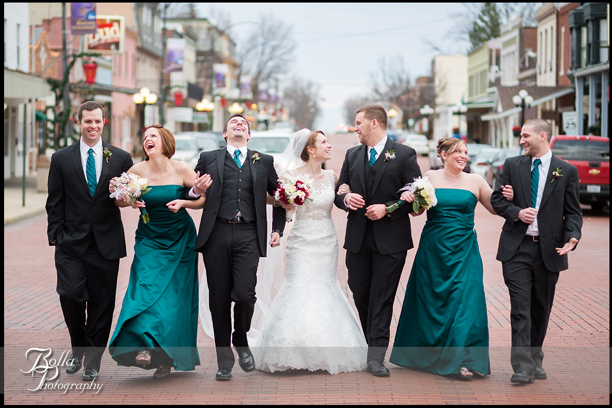 016-Bolla-Photography-Saint-Louis-wedding-photographer-McKendree-Bothwell-Chapel-Lebanon-IL-ceremony-Regency-OFallon-IL-reception-bride-groom-bridesmaids-groomsmen-usher-walking-laughing-brick-road-street-buildings-McClain.jpg