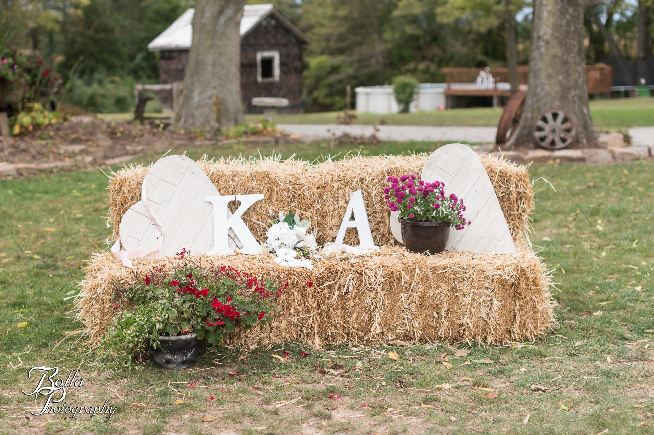Bolla_photography_edwardsville_wedding_photographer_st_louis_weddings_Amber_Korsmeyer_Kyle_Gruner_Schwarz_Barn_blue_jeans_pickup_truck_autumn-0092.jpg