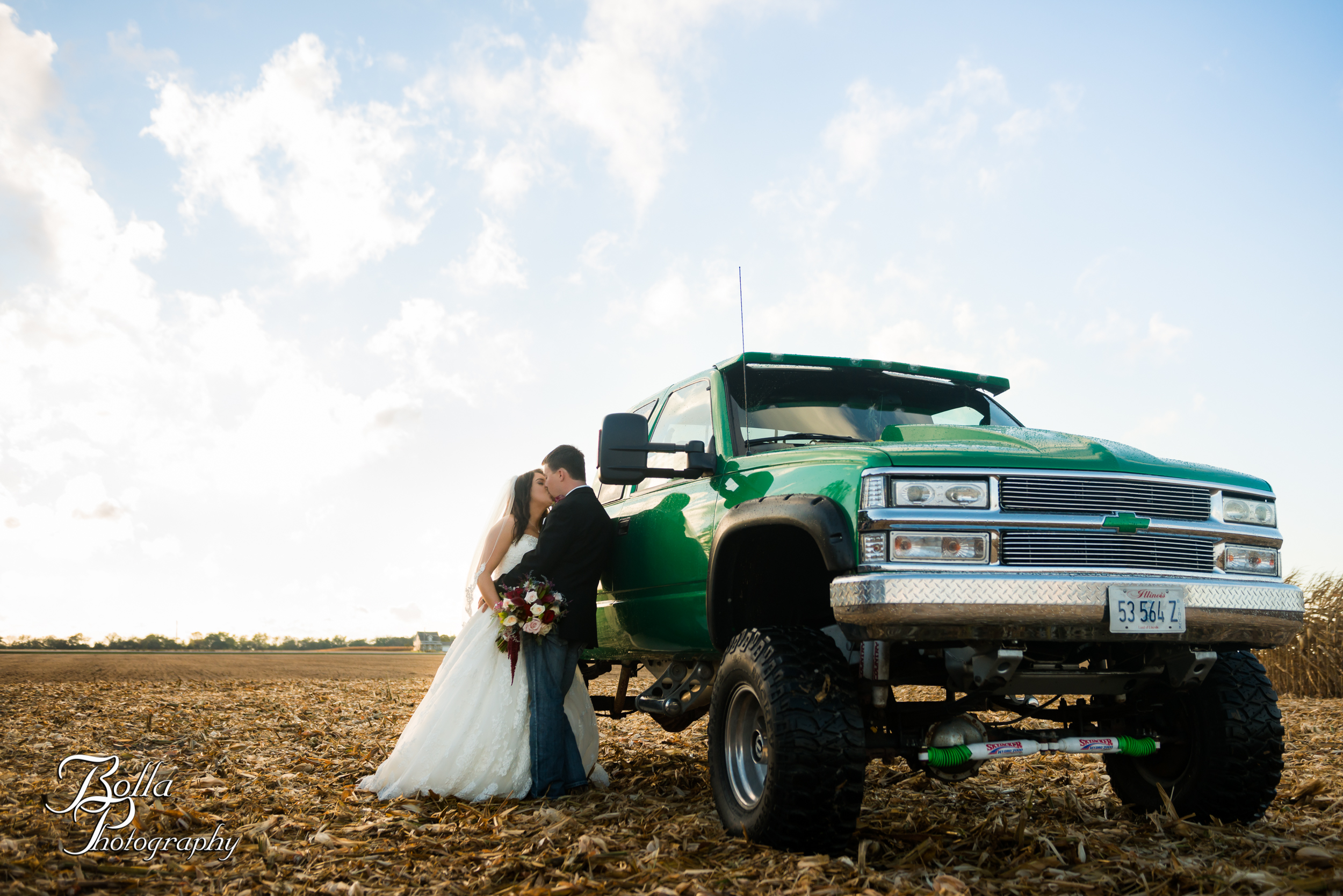 Bolla_photography_edwardsville_wedding_photographer_st_louis_weddings_Amber_Korsmeyer_Kyle_Gruner_Schwarz_Barn_blue_jeans_pickup_truck_autumn-0003.jpg