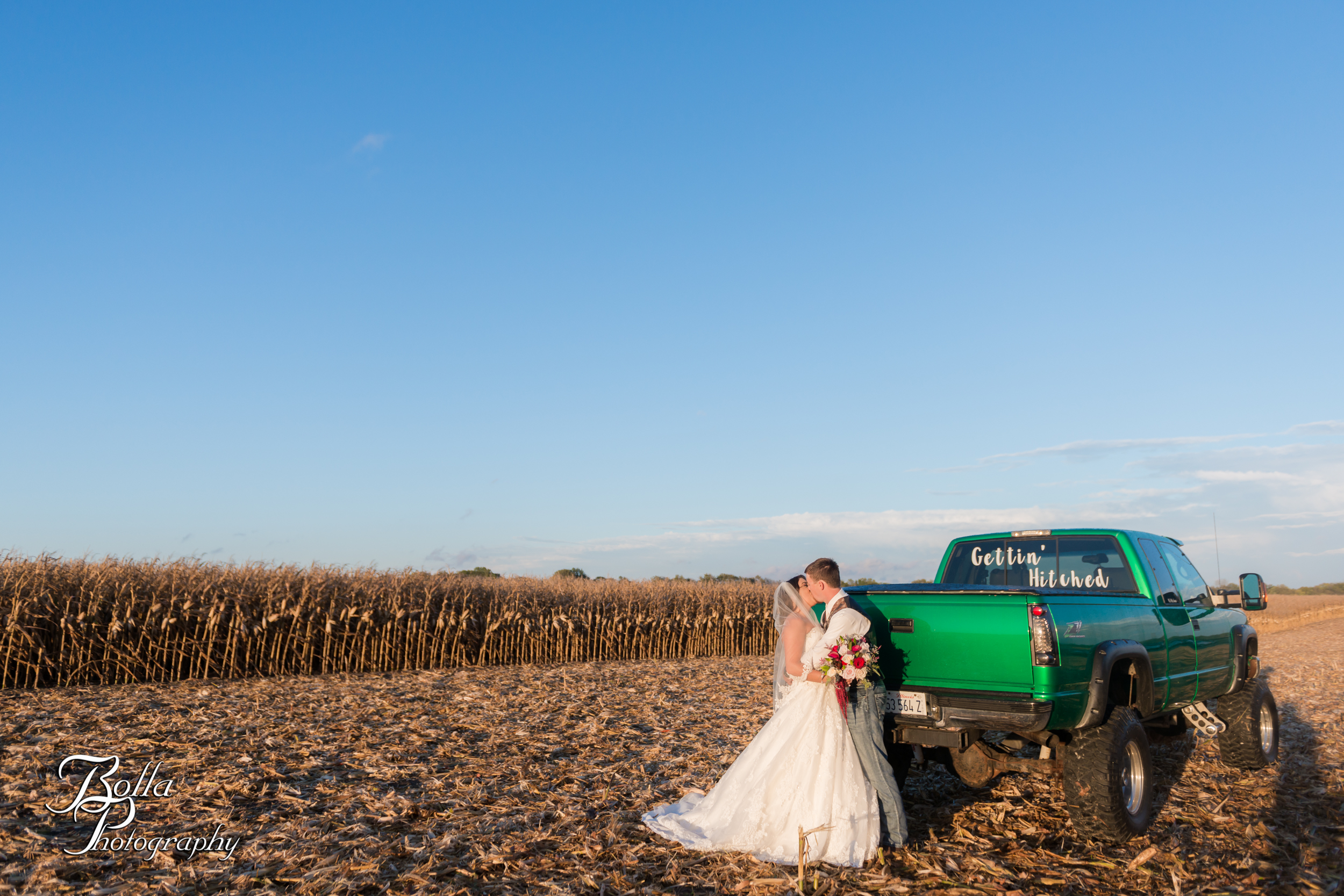 Bolla_photography_edwardsville_wedding_photographer_st_louis_weddings_Amber_Korsmeyer_Kyle_Gruner_Schwarz_Barn_blue_jeans_pickup_truck_autumn-0325.jpg