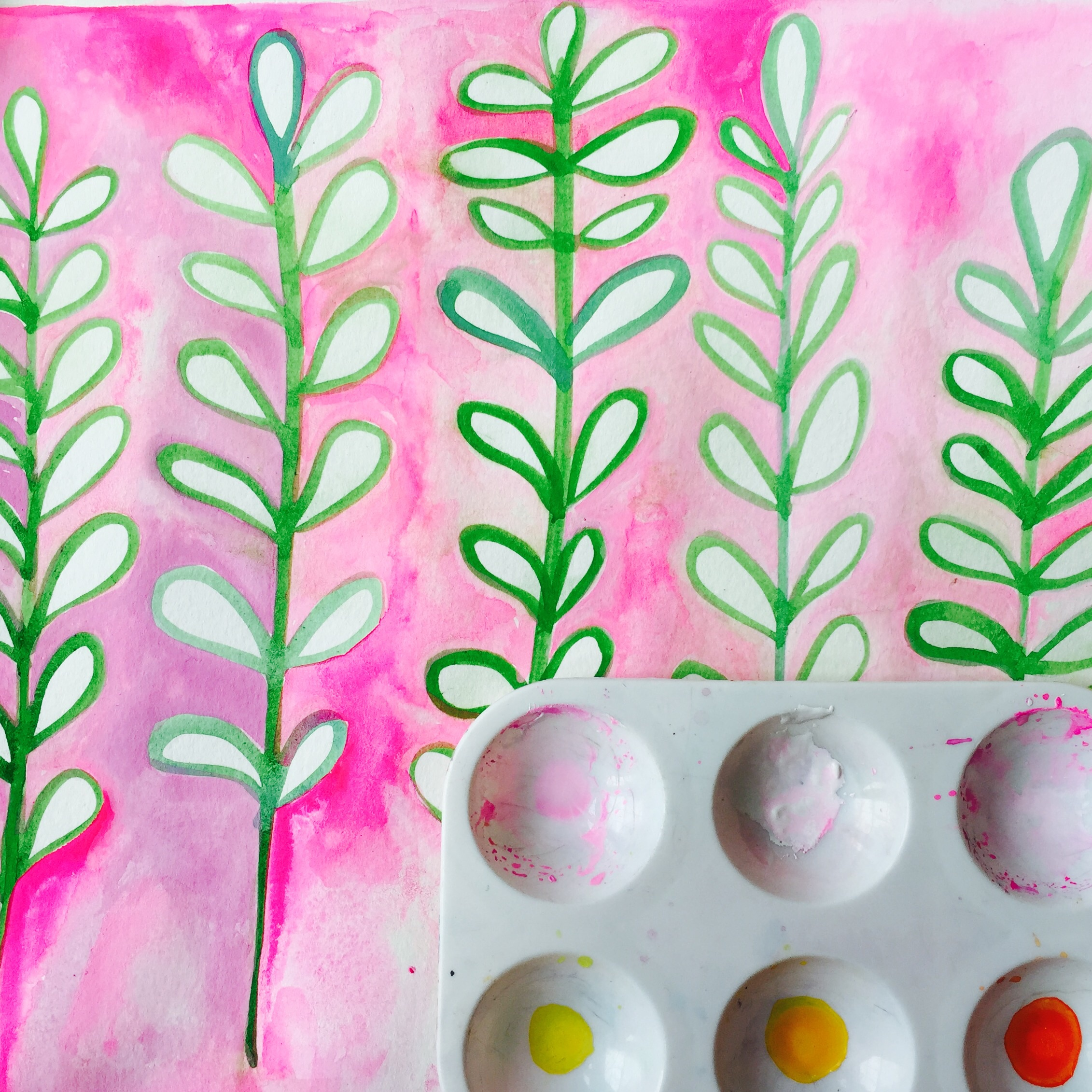 painted green leaves first with gouache then the pink background