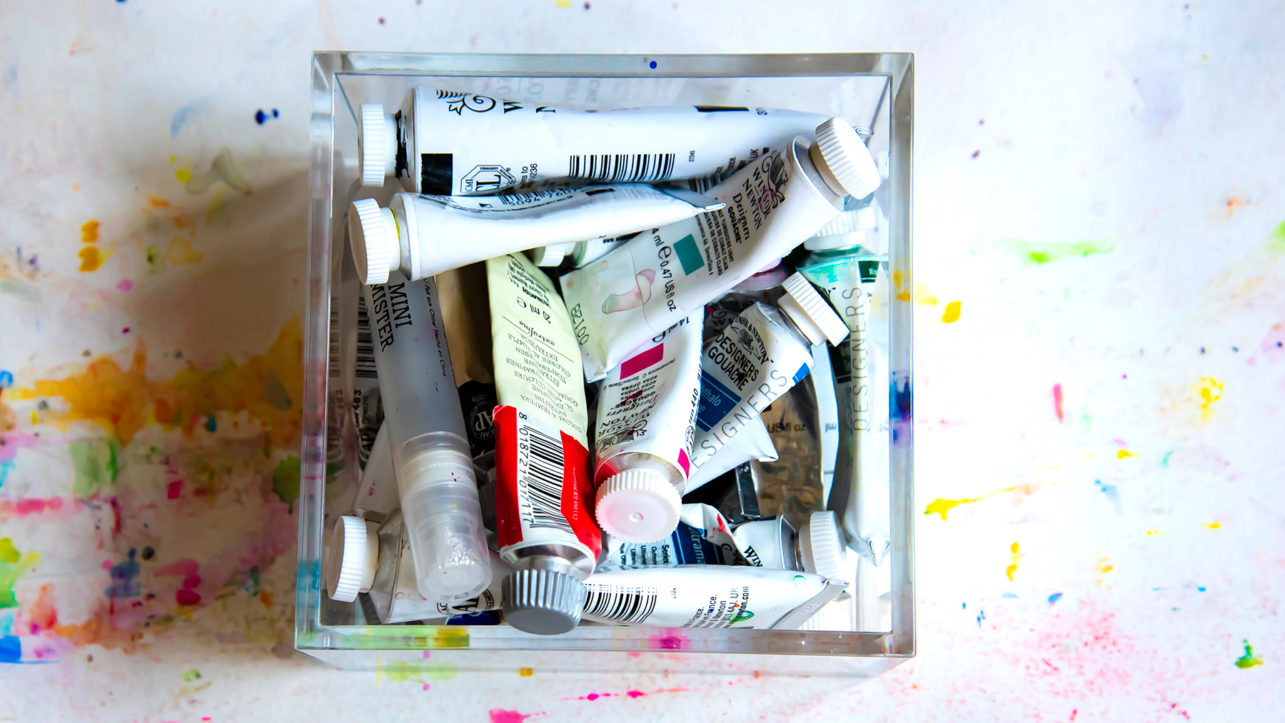 All of my gouache paint tubes fit in one clear container.
