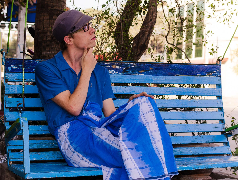 Pondering life in a blue longyi. Mandalay, Burma / Myanmar