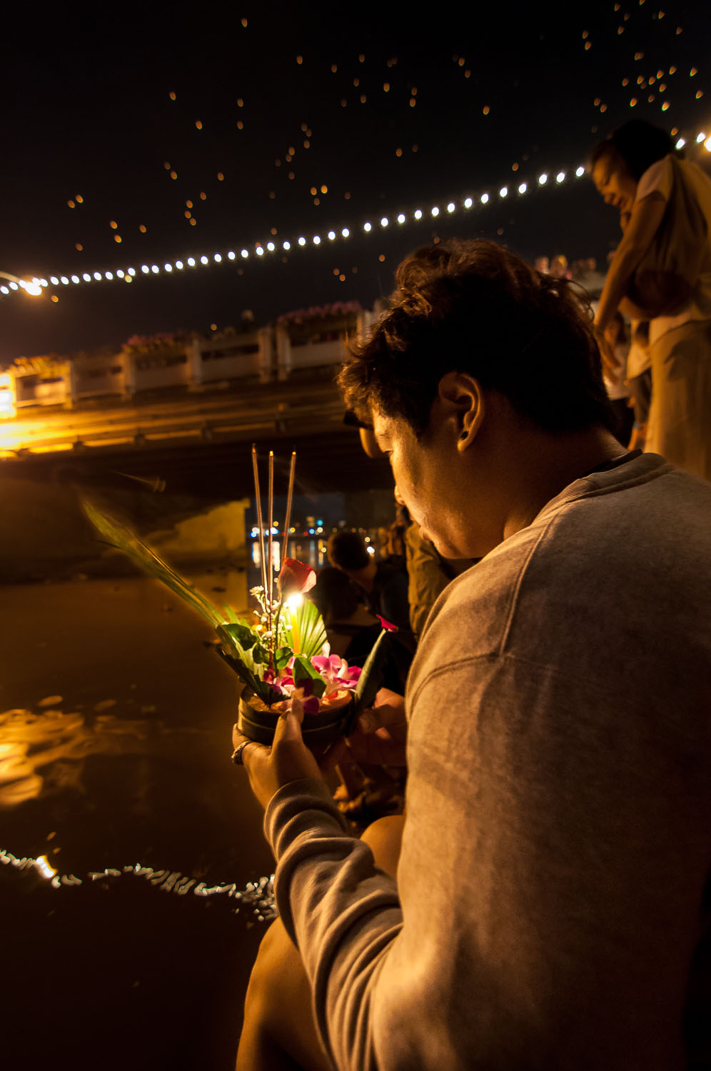 A woman prepares to release the krathong into the river in Chiang Mai, Thailand.