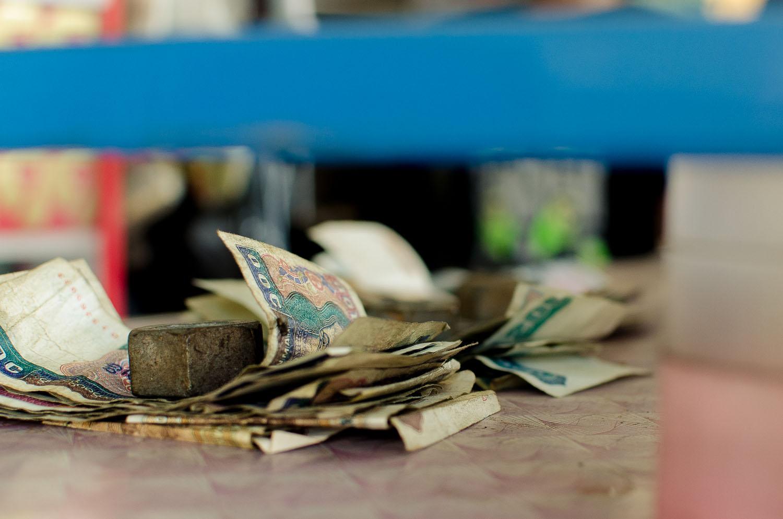 Standard money management for a business in Myanmar (Burma)  (c) Dustin Main 2013