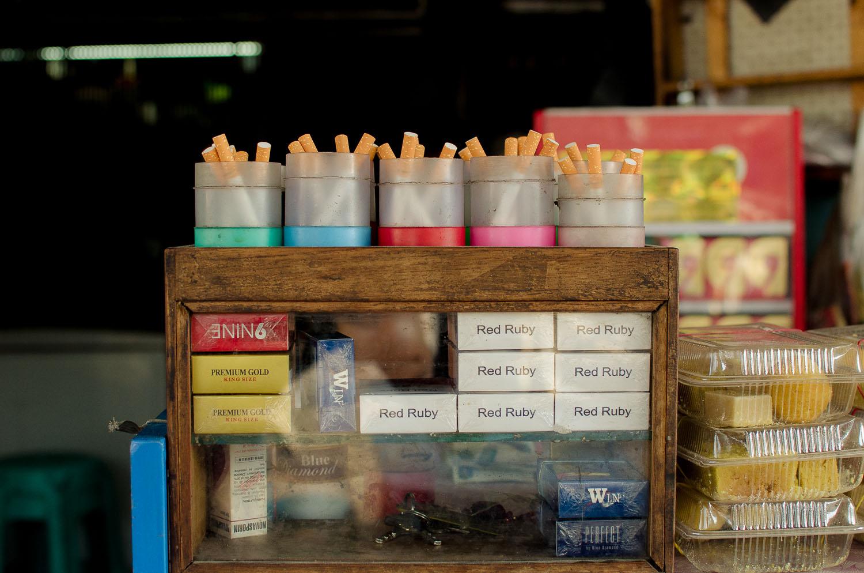 Cigarettes by the single. Shwe Ya Minn tea shop in Kalaw (Shan State)  (c) Dustin Main 2013