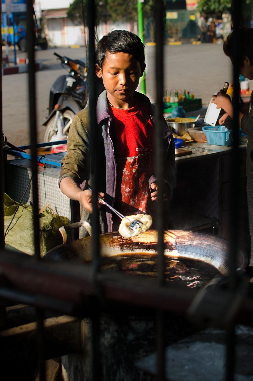 Kyaw Myint Than making puri shortly after sunrise in Kalaw, Myanmar (Burma)  (c) Dustin Main 2013