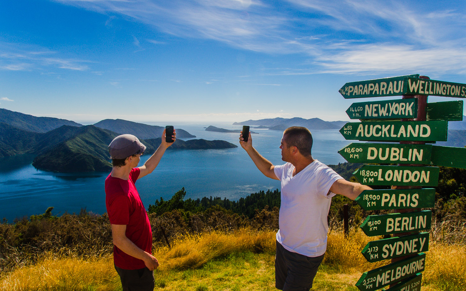 Dustin and Dave searching for signal along the picturesque Queen Charlotte Track in the Marlborough Sounds, New Zealand.  © Dustin Main 2013