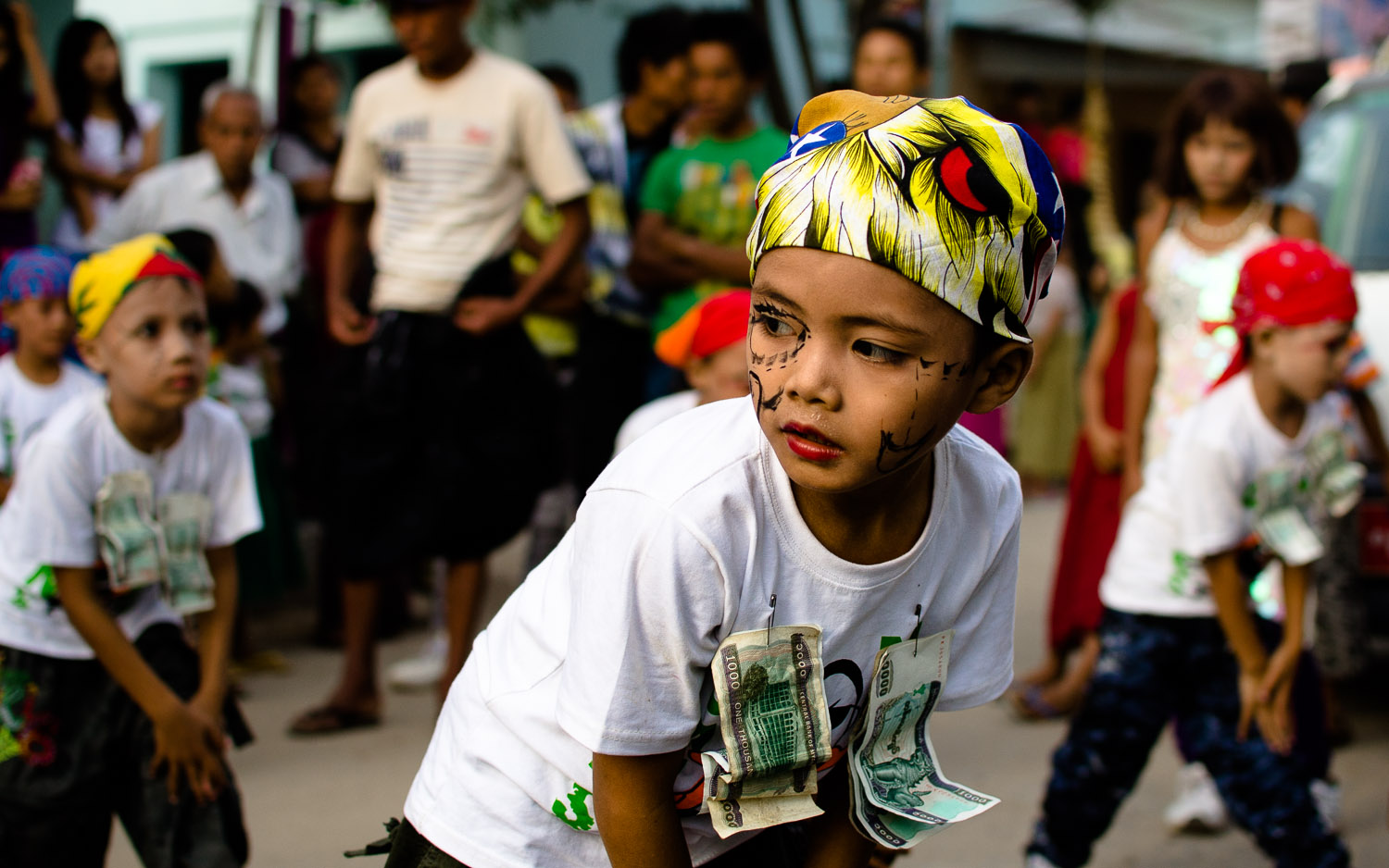 Young dancer showing his moves as part of the procession for the Shwezigon Pagoda Festival in Nyaung U (Bagan), Myanmar / Burma.  © Dustin Main 2014