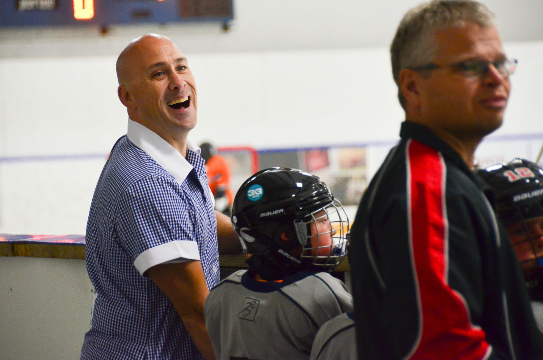 Jeff coaches hockey, in a dress.   © Dustin Main 2013