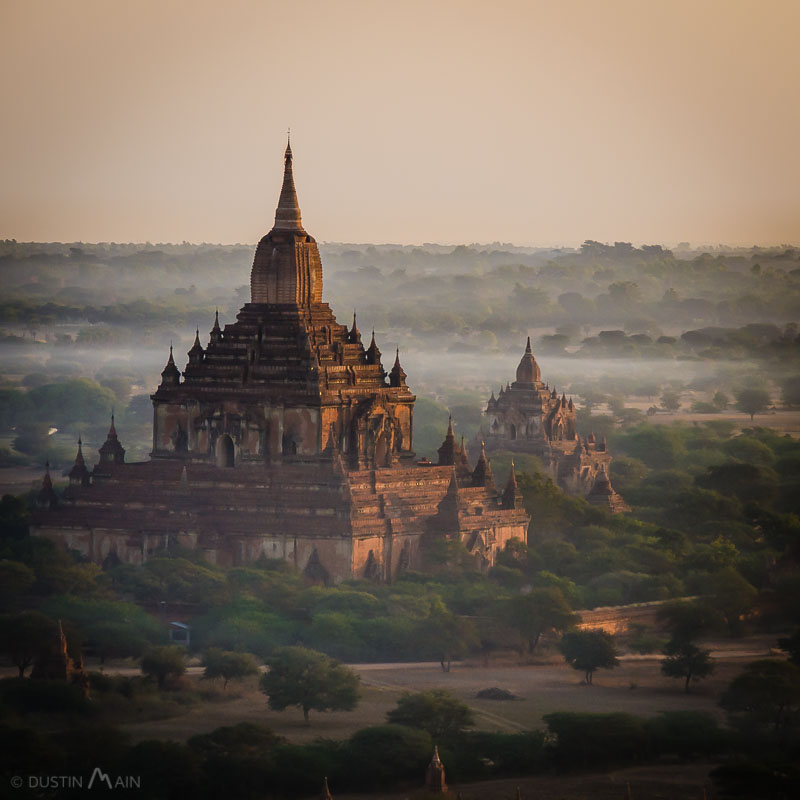 800 year old Htilominlo Temple in Bagan rises high above the early morning smoke and fog in Myanmar's Bagan plain.   © Dustin Main 2014