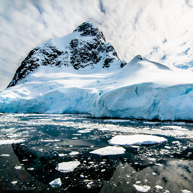 Black water, blue ice, and white snow in Antarctica. © Dustin Main 2014