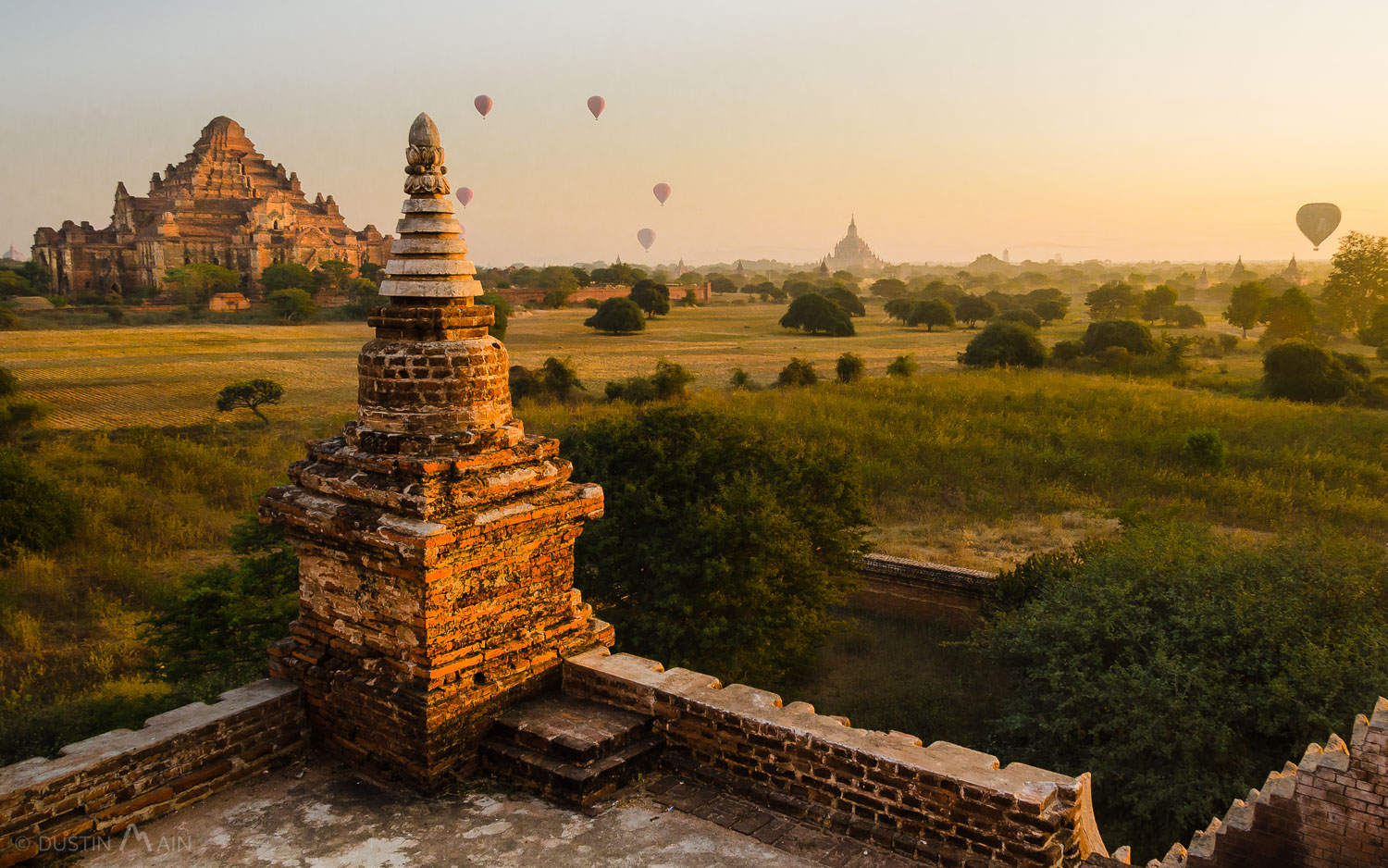 Hot air balloons fill the sky after sunrise in Bagan