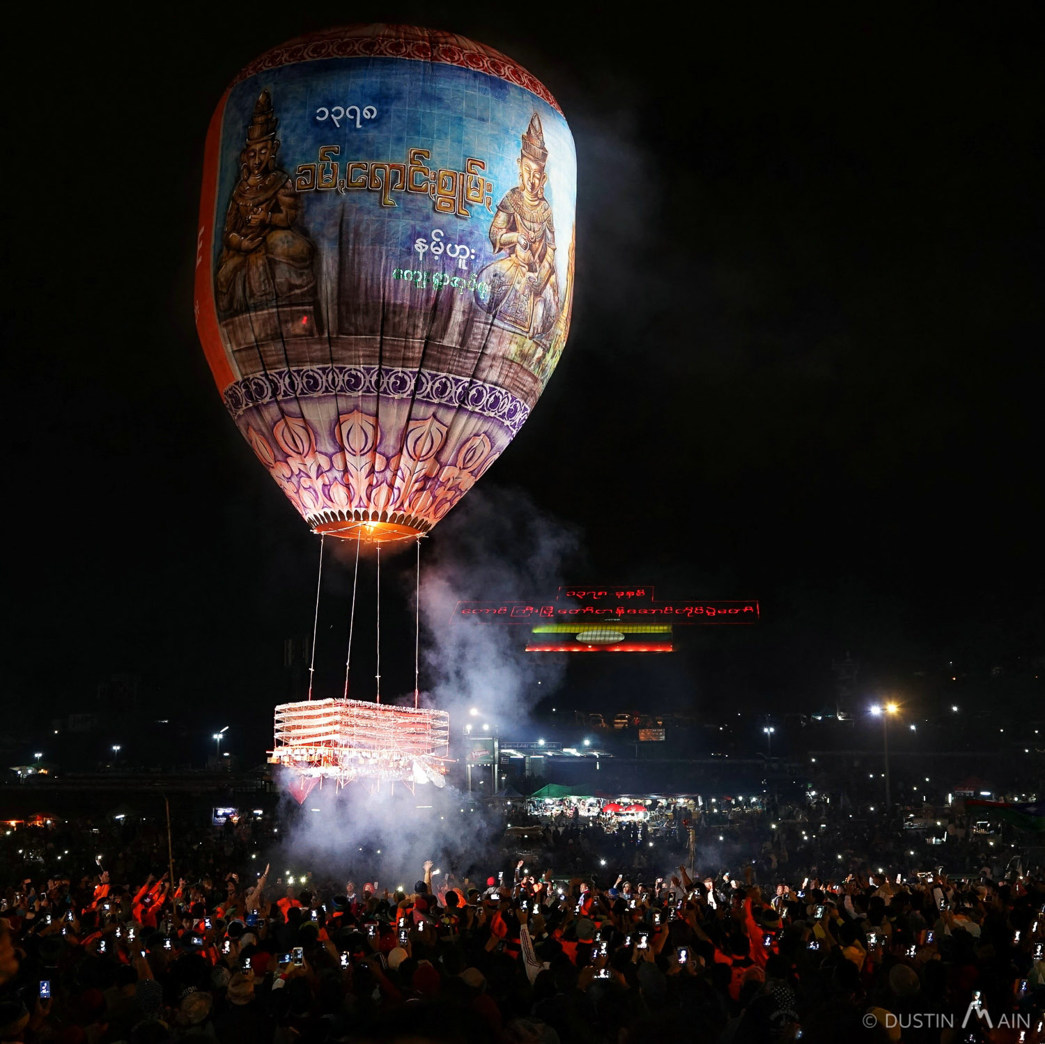 A fire balloon lifts off near Taunggyi at the second biggest festival in Myanmar. © Dustin Main 2016