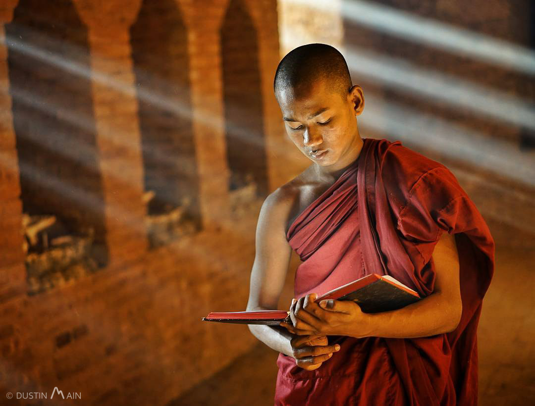Novice monk Po Htein studies near the monastery near Ananda Temple in Bagan, Myanmar © Dustin Main 2016