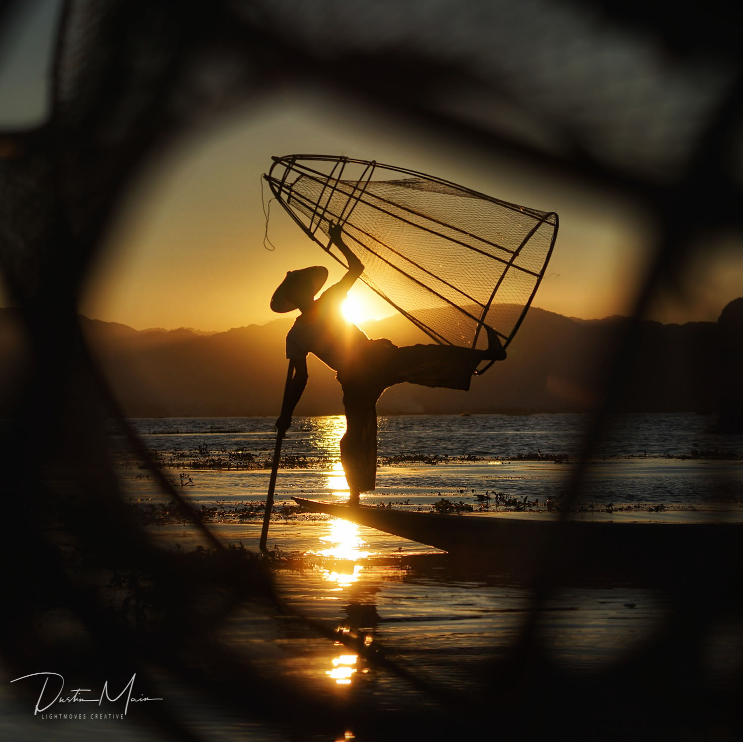 A fisherman performs a delicate balancing act on stunning Inle Lake at sunset.  © Dustin Main 2017