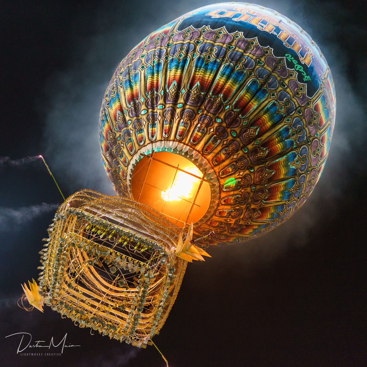 Nya Mee Gyi fire balloon moments after launch as just before the fireworks begin. Taunggyi, Myanmar.  © Dustin Main 2015