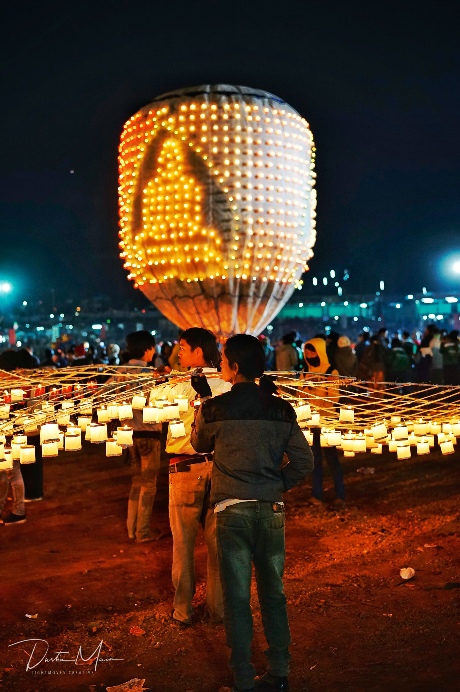 The candles on the fire balloon make the shape of a Buddha.  © Dustin Main 2016