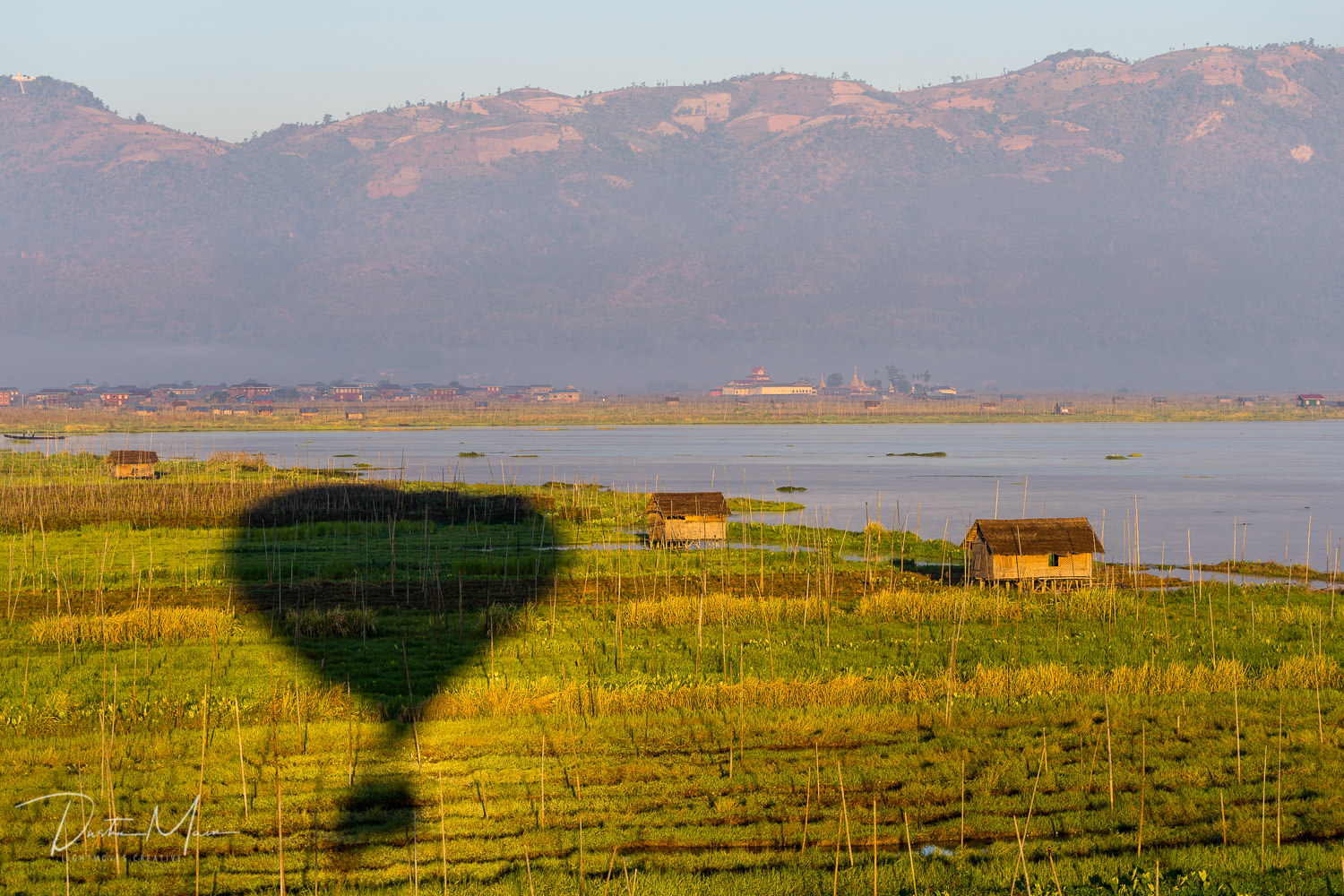 Shadow of the balloon captured on the floating gardens of Inle Lake.  © Dustin Main 2017