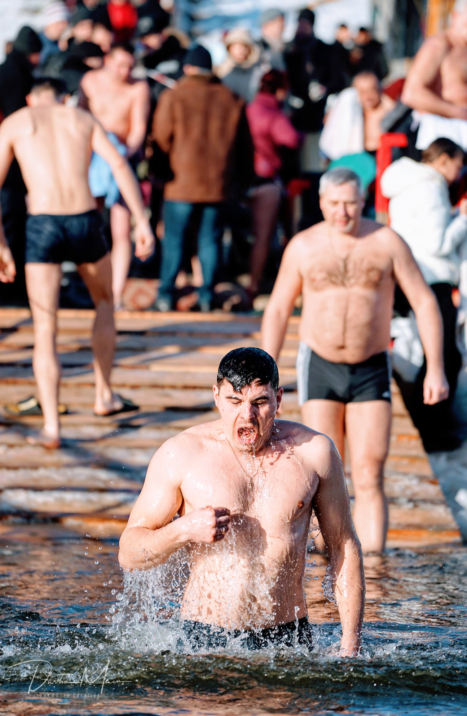 Expressions of a man as he experiences the frozen waters of the Dnieper River during Epiphany. © Dustin Main 2019