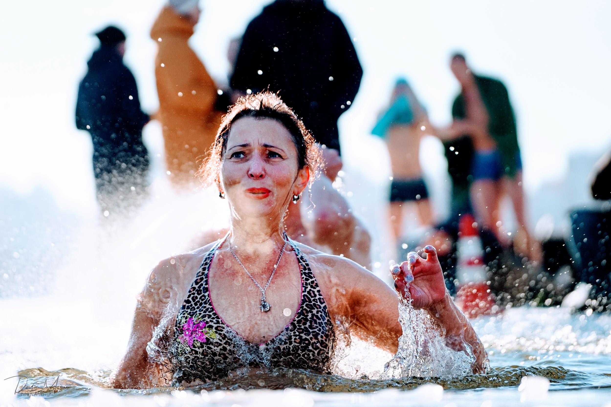 A woman feels the cold during her Epiphany swim. About 10-20% of those who entered the river were women. © Dustin Main 2019