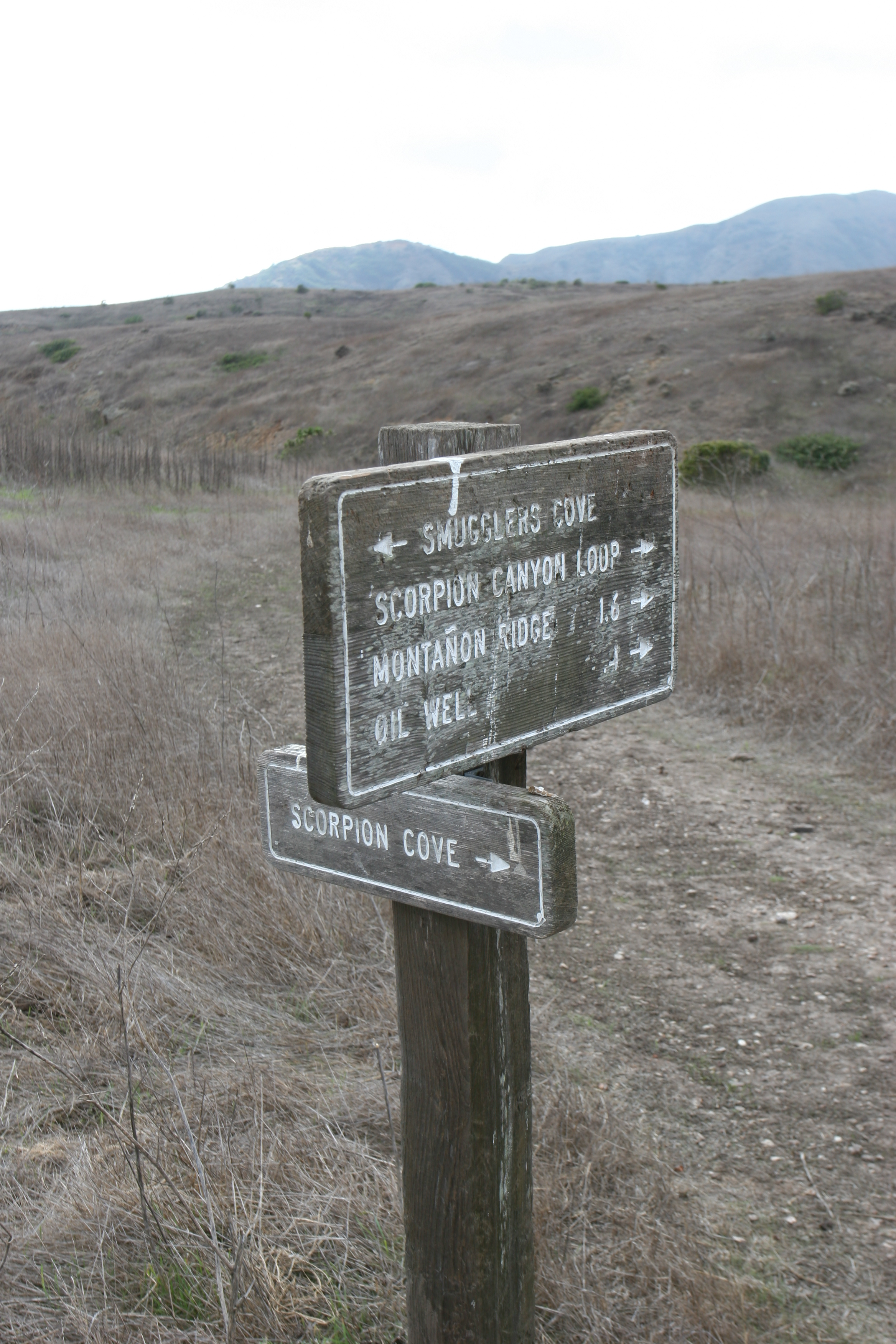The sign at the two mile marker for the turnoff to the oil well