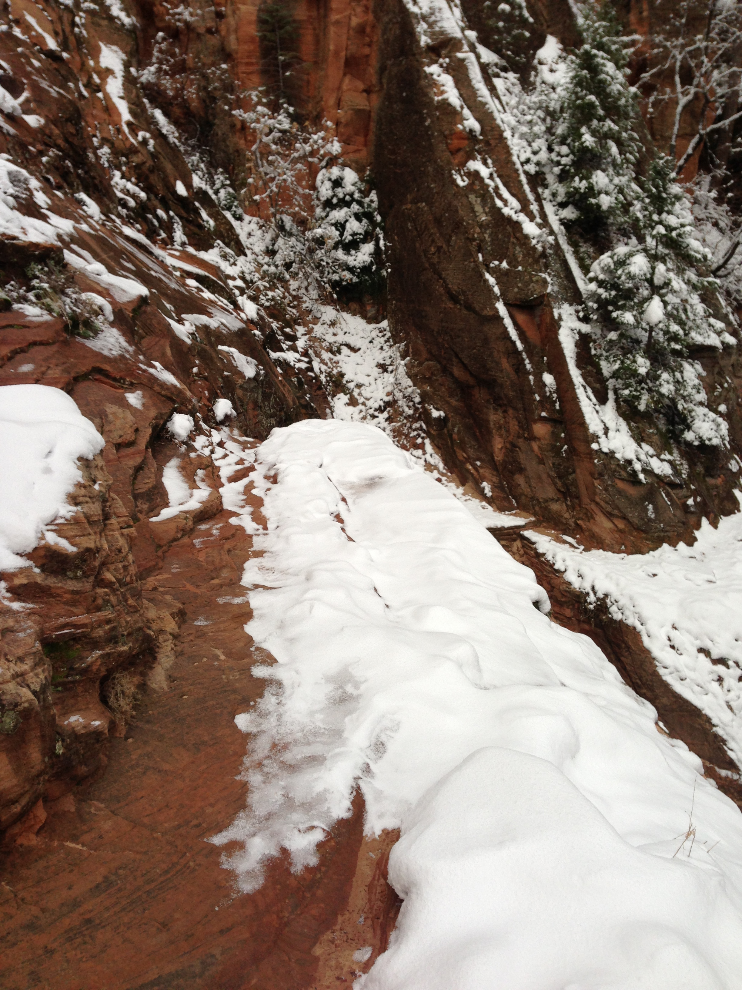 """This is the """"exposed"""" section I am discussing. 1-2 inches of snow/ice on sandstone; focus on the bump at the end, and you'll see my """"problem area"""". Photo taken December 2012."""