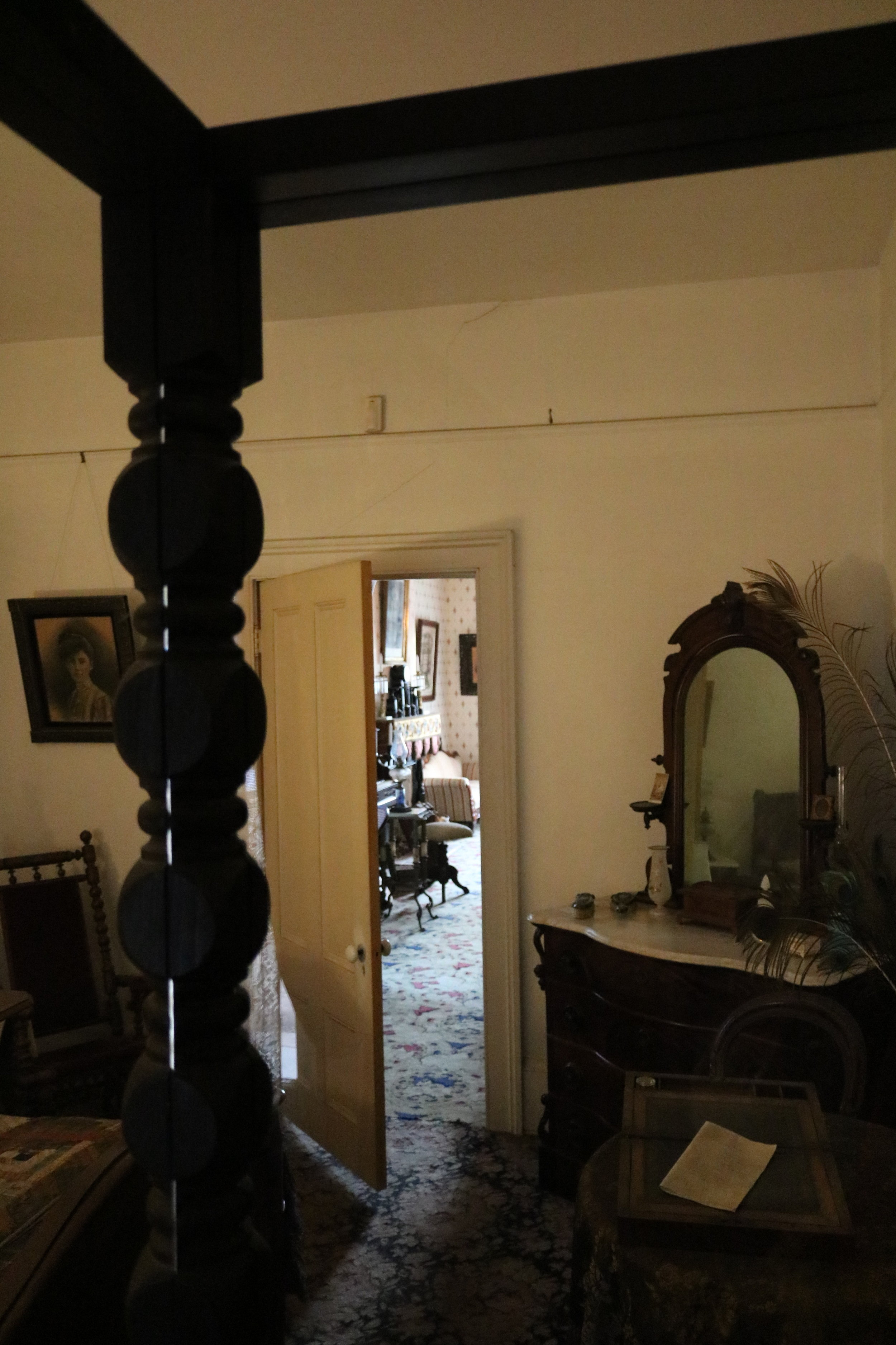 The back bedroom of the first story of the Whaley House has a number of paranormal rumors.