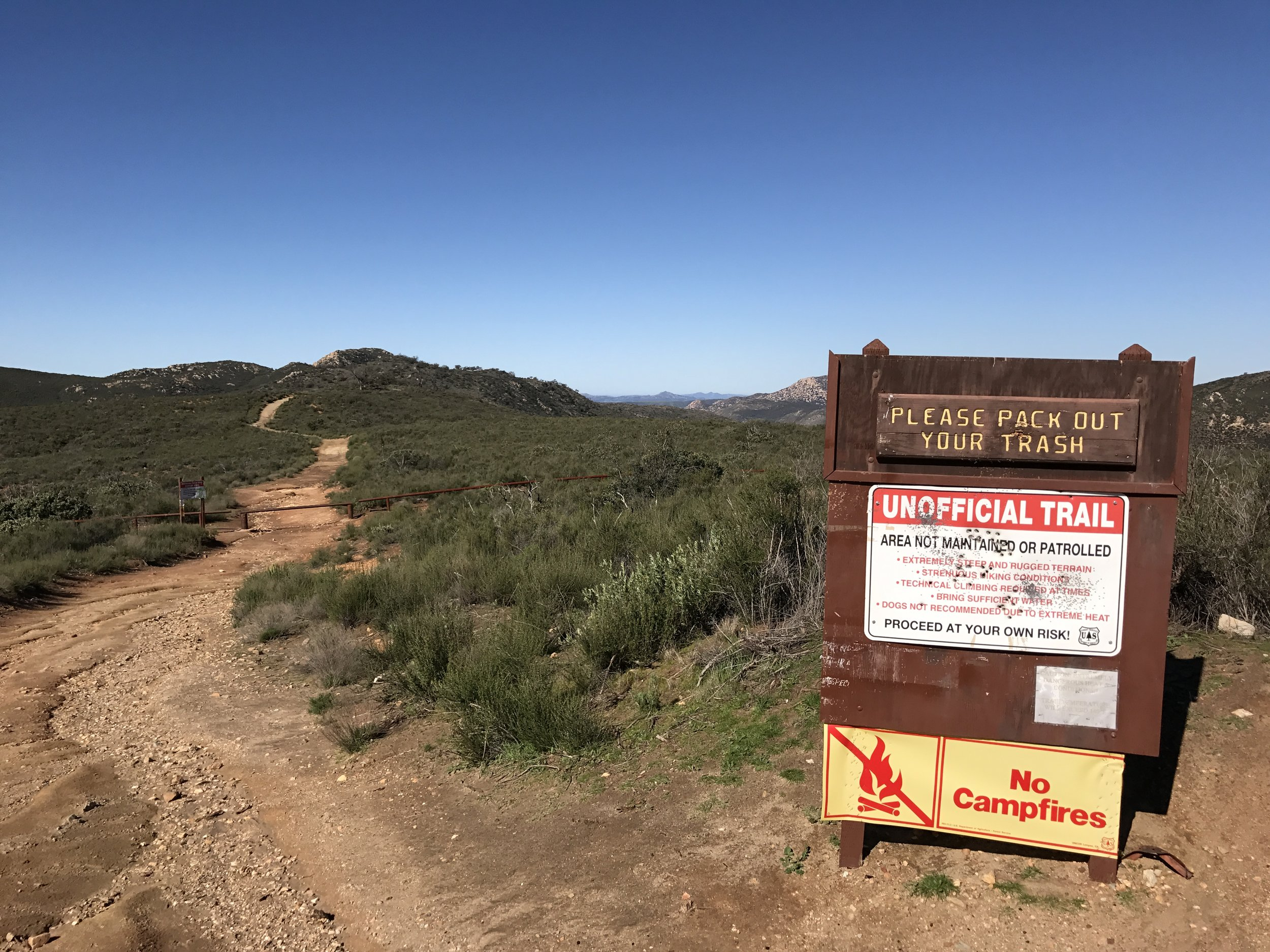 Trailhead warning signs for Three Sisters Falls.