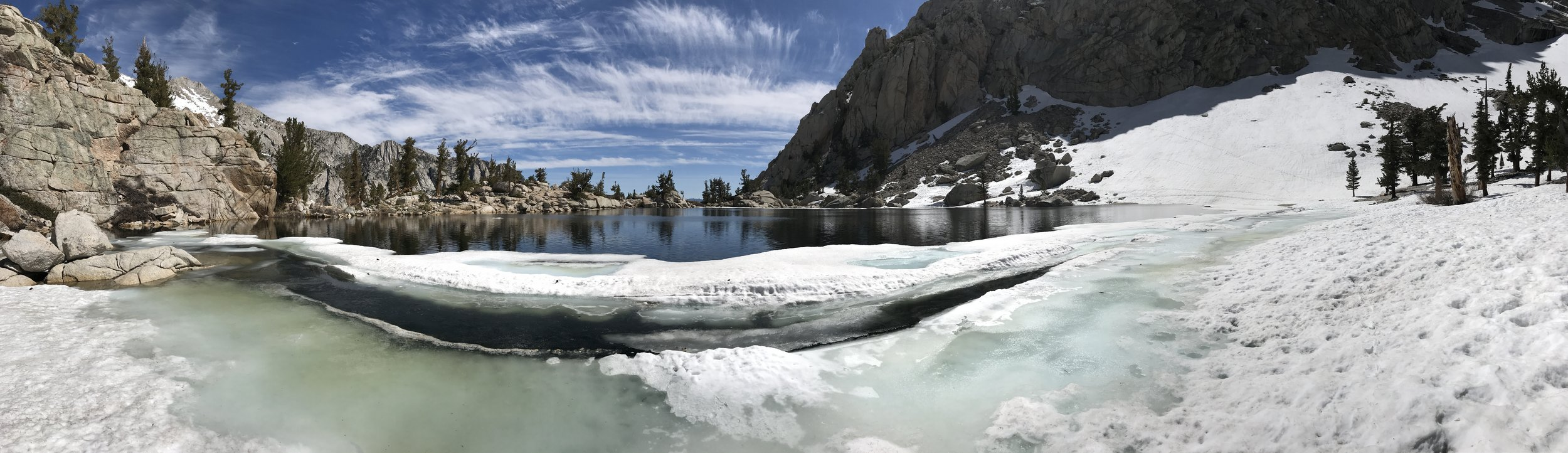 Lone Pine Lake appears to stretch off into infinity as its far side drops off.