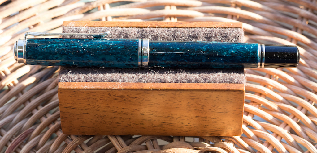 Yet this side of the pen is much darker with glimpses of turquoise.