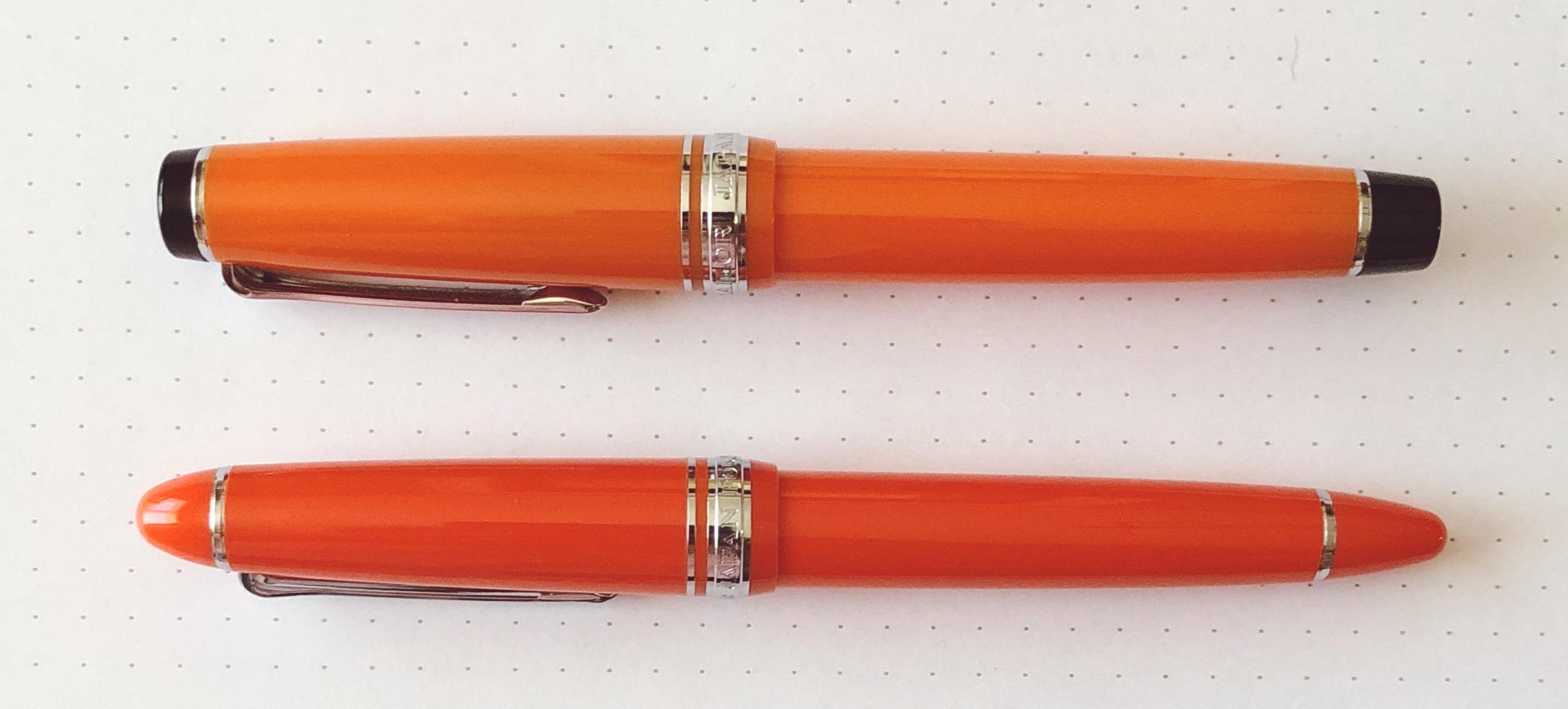 Pro Gear Orange (top) vs 1911 Standard Royal Tangerine