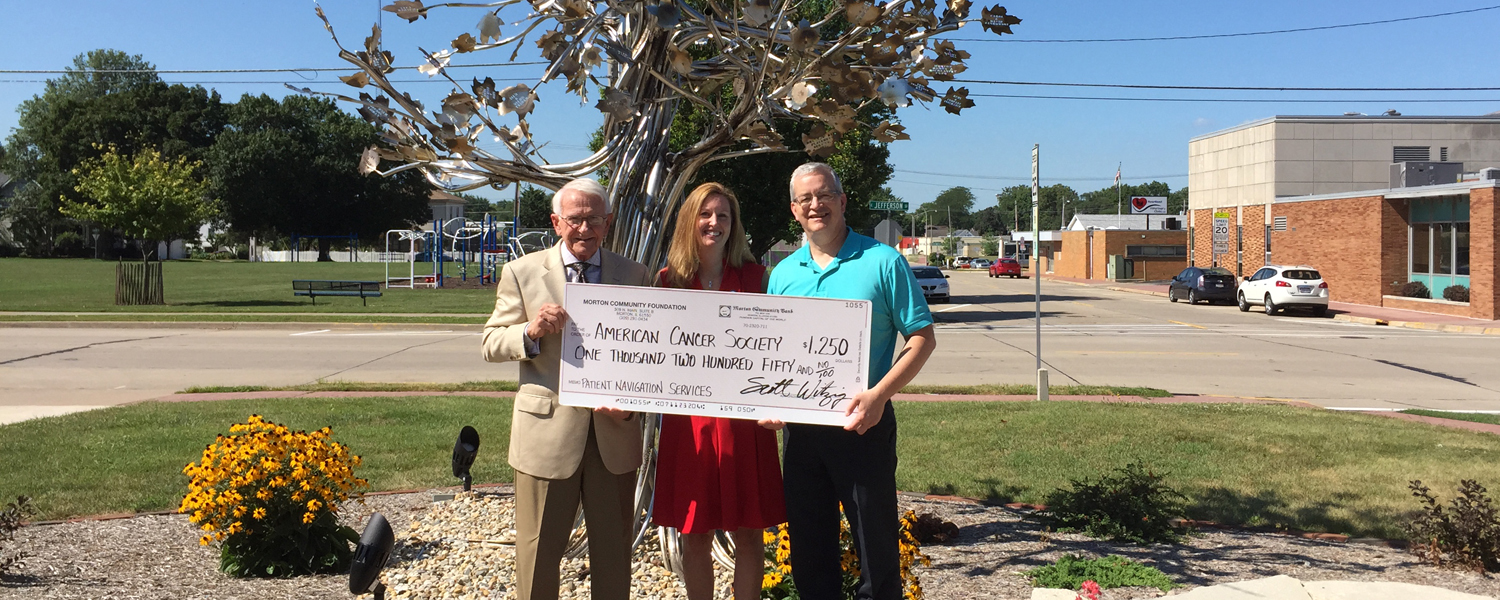 The first grant from the Cary Martin Memorial Cancer Services Fund was given to the American Cancer Society in 2015. Pictured l to r: Arlan Martin, father of Cary Martin; Brenda Miller, Sr Director of Estate & Gift Planning, American Cancer Society; Scott Witzig,, Executive Director, Morton Community Foundation.
