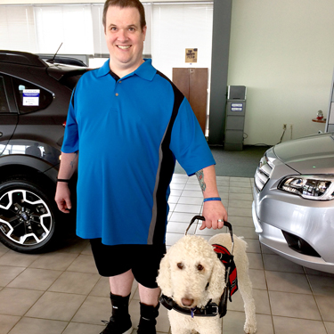 Todd and his service dog, Charlie.