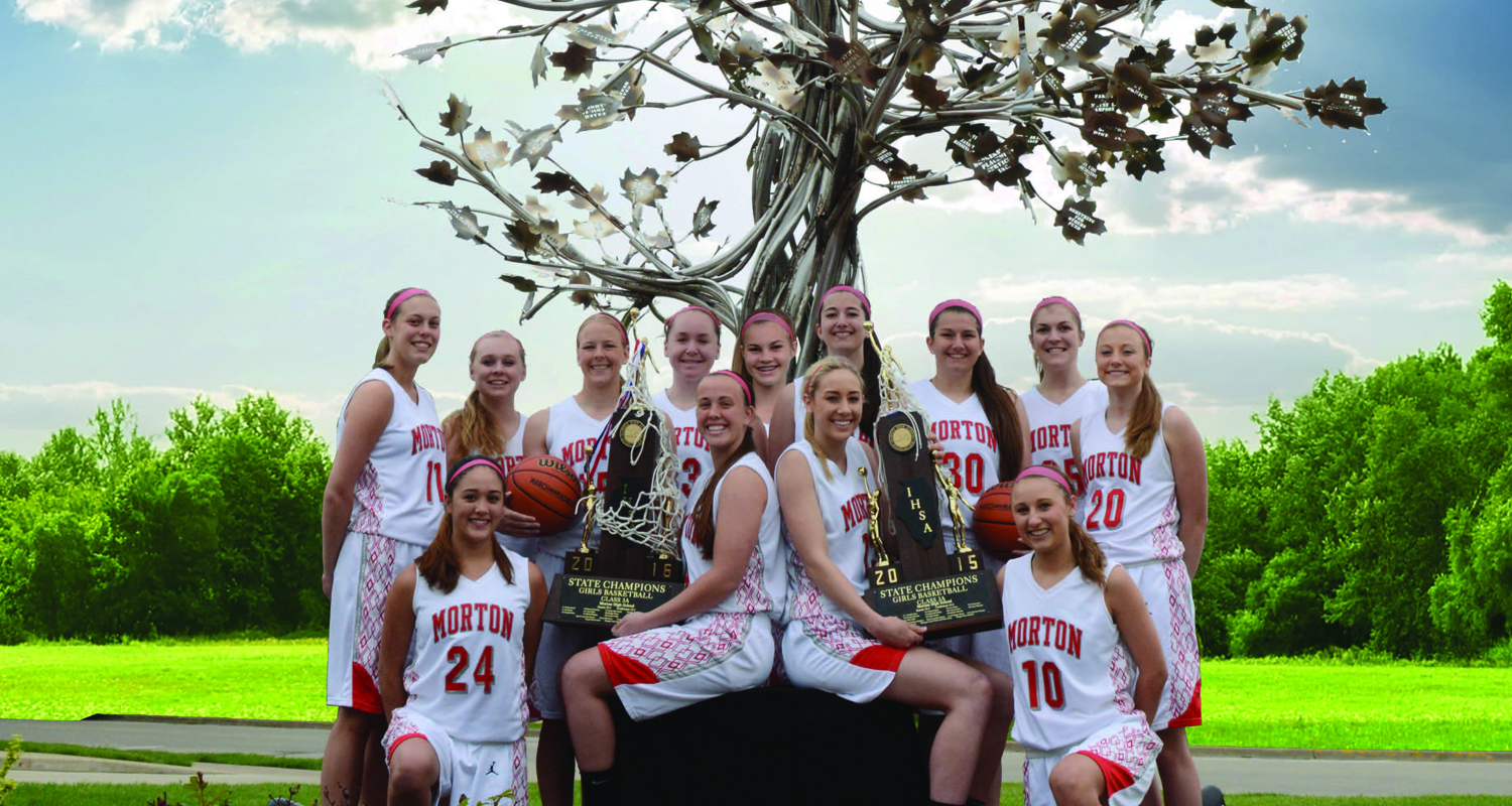 The MHS Girl's Basketball 2016 State Champion team shown holding both the 2015 and the 2016 State title trophies.