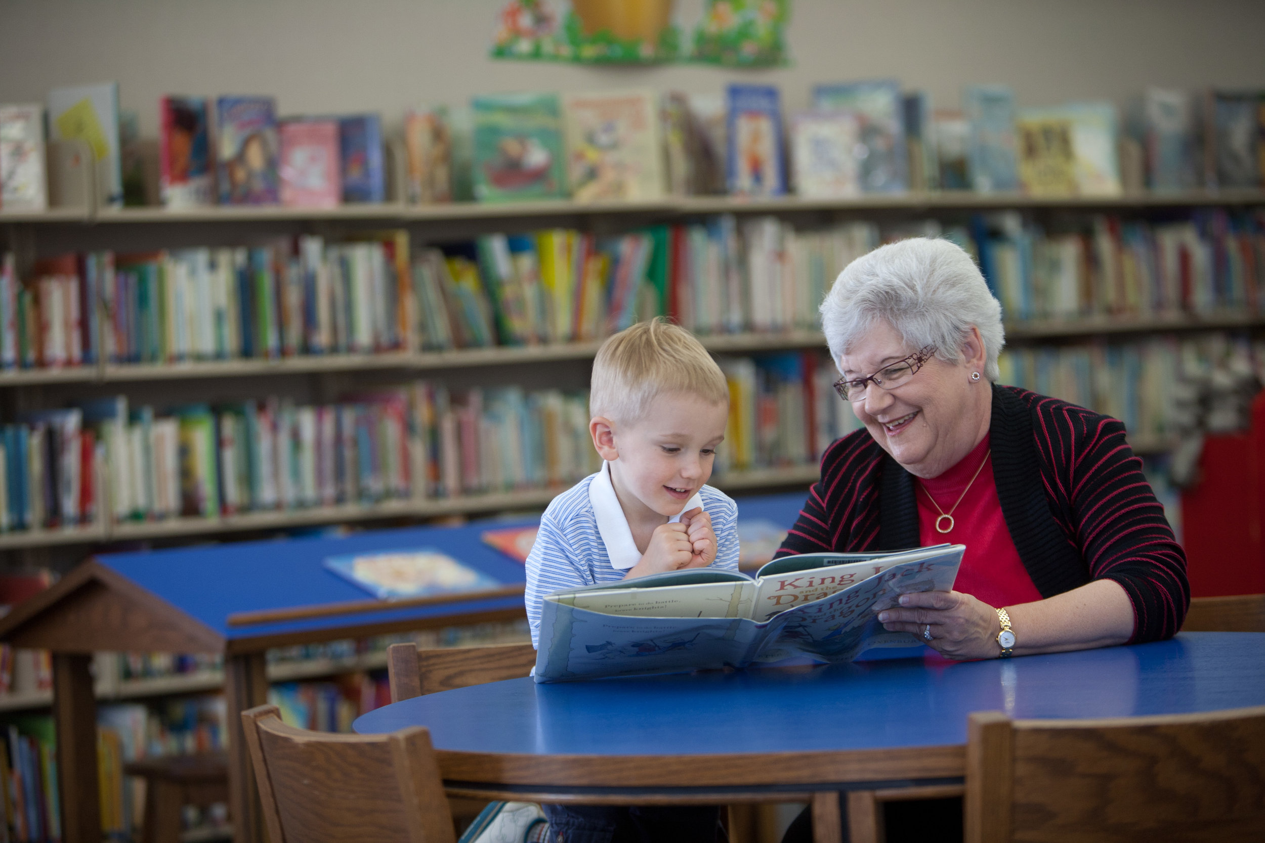 Lynne Walters reads a book to her grandson, North Thompson.
