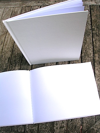 PORTRAIT book is standing in this photo. LANDSCAPE book is open, laying on the table. Hardcover Blank Books.