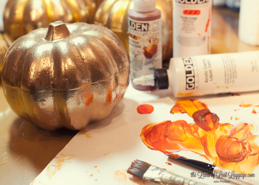 To bring the pumpkins from their $3 state up to a $15 look, I glazed on some Quinacridone Nickel Azo gold paint plus Vat Orange. The Acrylic Glazing Liquid (Golden) allows a long working time so I can lay in some color and then come back in with a clean brush to blend it around. I applied some of the orange mixture in all of the dips.
