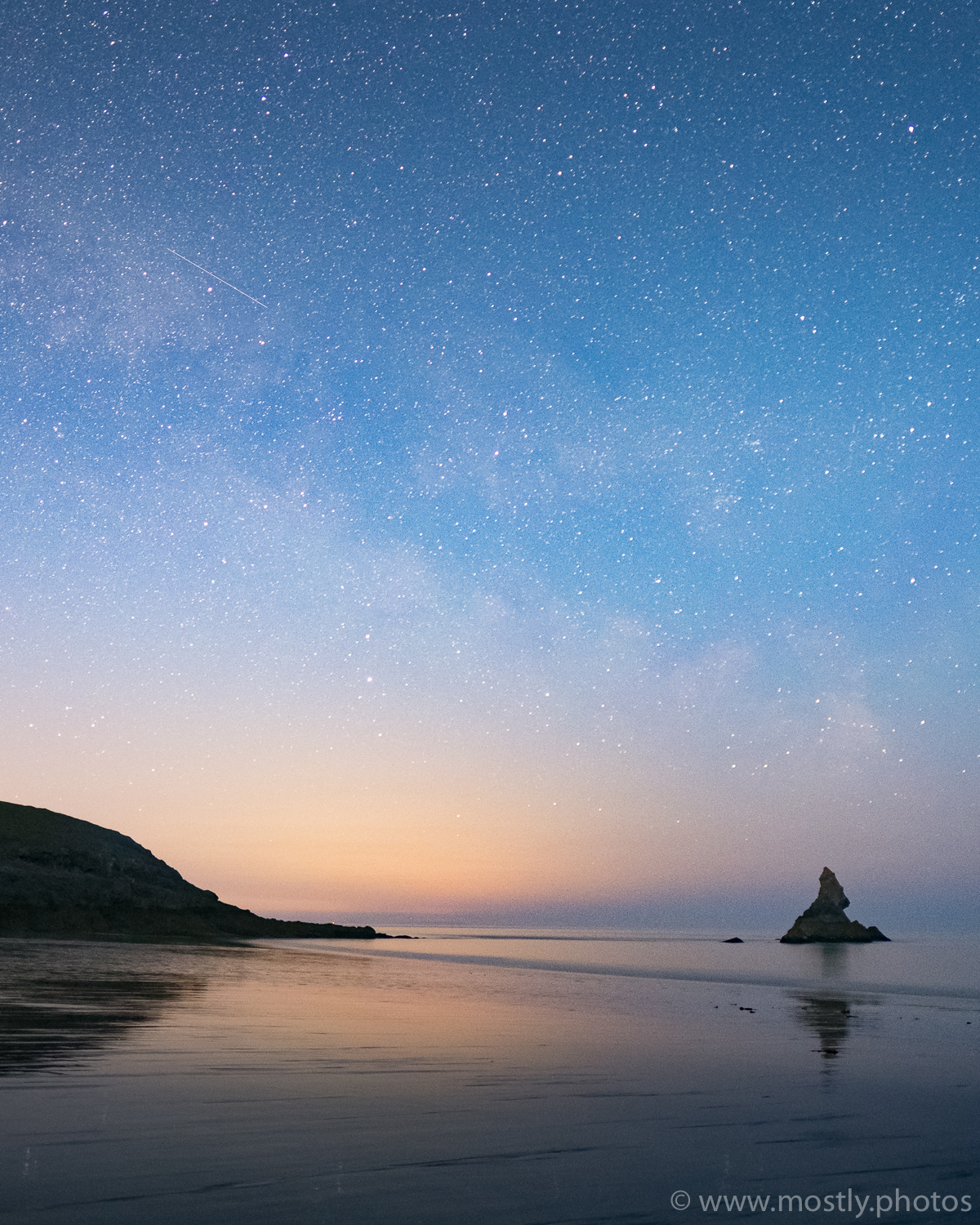 Fuji X-T2 - Fuji 16mm f1.4 - (20 second exposure, ISO 3200, f1.4)  Milky Way and shooting Star over Church Rock  - Broad Haven Beach, Wales