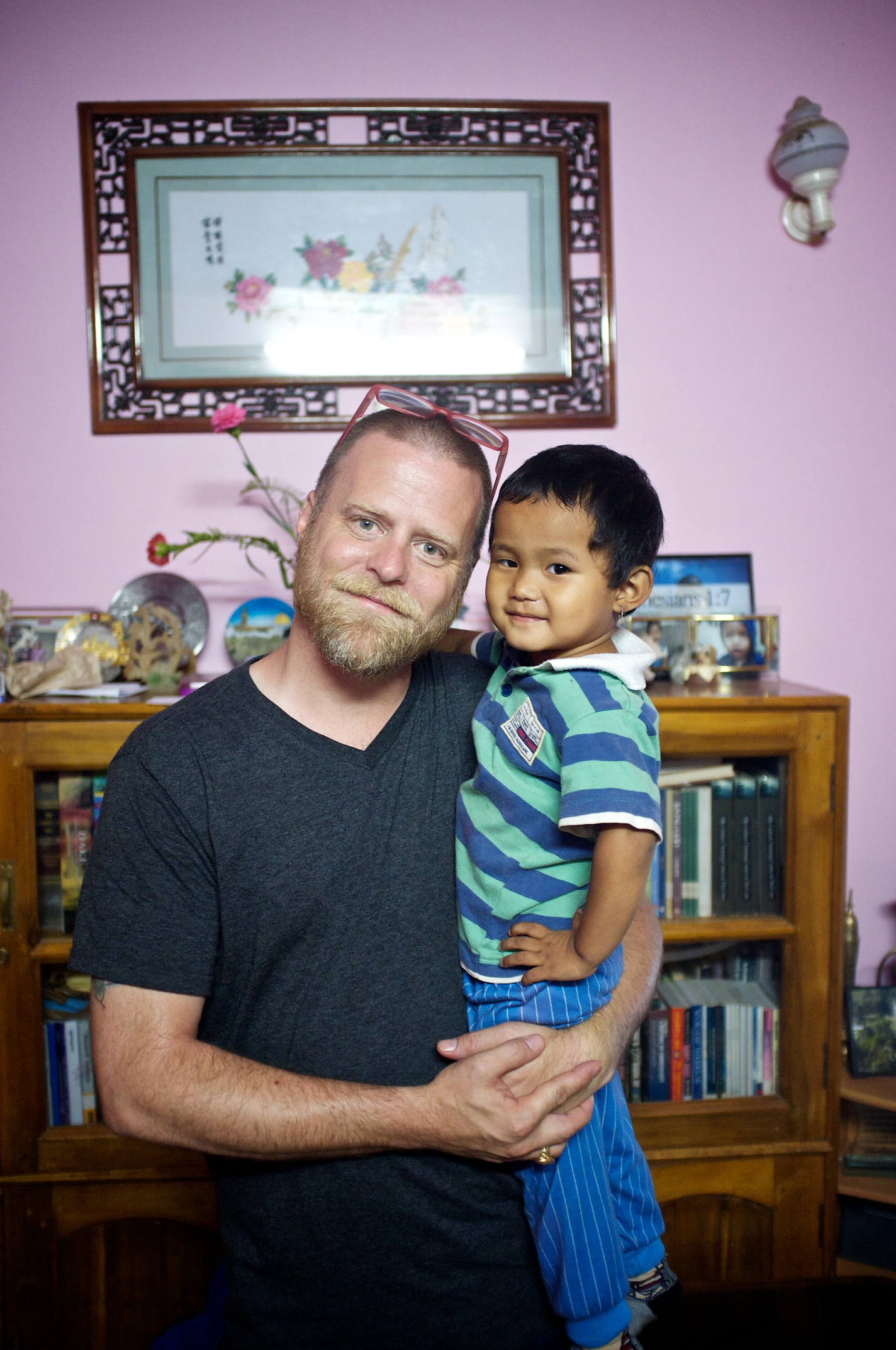 Executive Director John McCollum with 3 year old Anjela